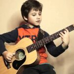 The Incorporation Of Music And Guitar In The Development Of Children